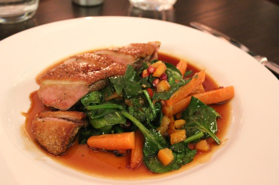 Duck Breast with orange, pomegrate and roast carrots